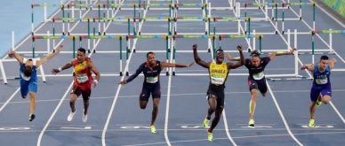 Jamaica's Omar McLeod, center right, wins the men's 110-meter hurdles final ahead of second placed Spain's Orlando Ortega, second left, third placed France's Dimitri Bascou, center left, fourth placed France's Pascal Martinot-Lagarde, second right, and fifth placed United States' Devon Allen during the athletics competitions of the 2016 Summer Olympics at the Olympic stadium in Rio de Janeiro, Brazil, Tuesday, Aug. 16, 2016. (AP Photo/Martin Meissner)